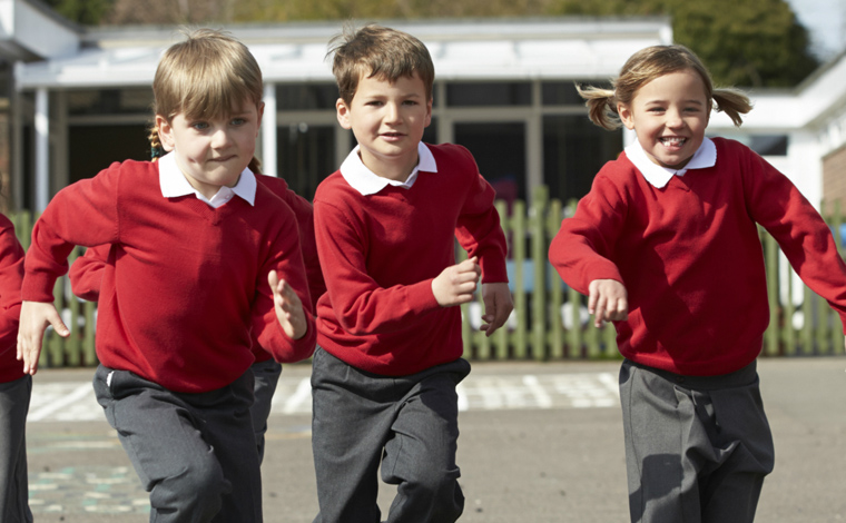 children running in playground for daily mile